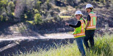 Workers survey outdoor job site
